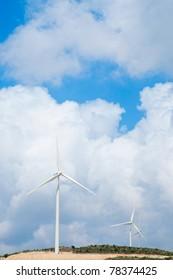 Wind power generators  against blue sky