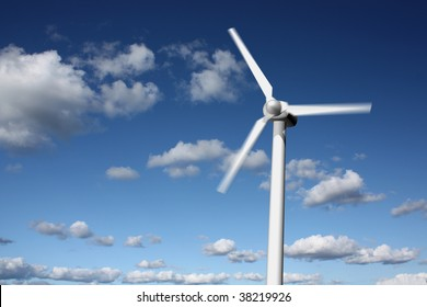 Wind power plant closeup with motion blur, sky and clouds in the background