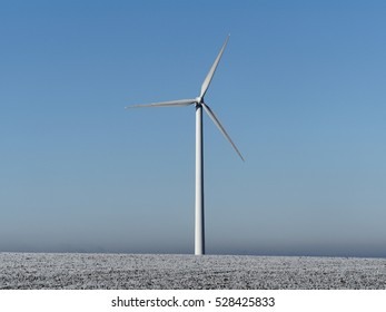 wind power plant in early morning light in austria