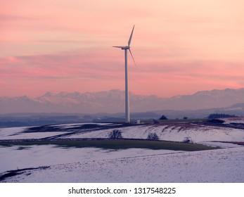 wind power plant in front of austrian alps