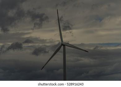 Wind power plant near Komari vizka hill in autumn time