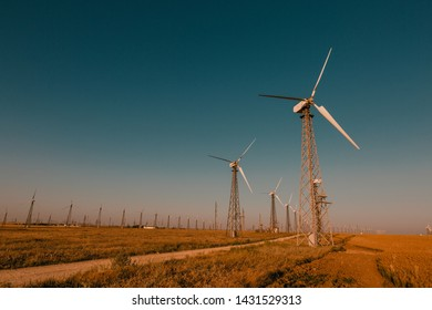 Wind power plant at sunset