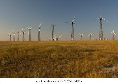 Wind power plant at sunset. Green energy generation. Yevpatoriya, Crimea.