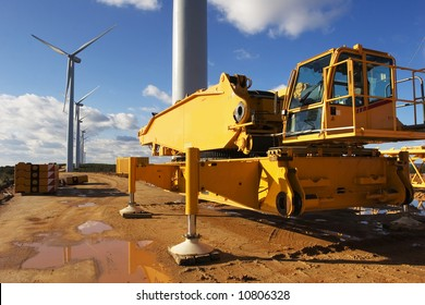 Wind power plant under construction. Mobile crane and wind turbine