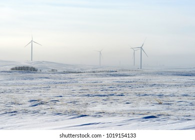 Wind power plants in winter. Wind power is the use of air flow through wind turbines to mechanically power generators for electric power.