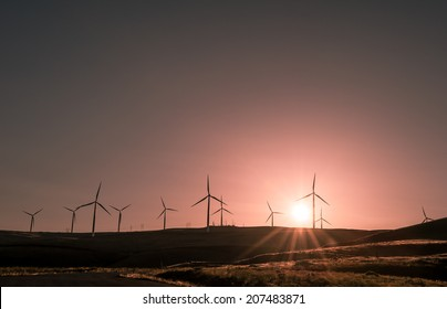 Wind power producing clean sustainable energy in a beautiful sunset