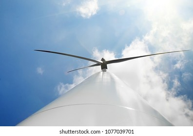 A wind power, propeller and sky