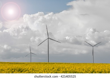 Wind power station at the yellow field