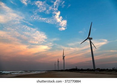 Wind power the sunset on the beach