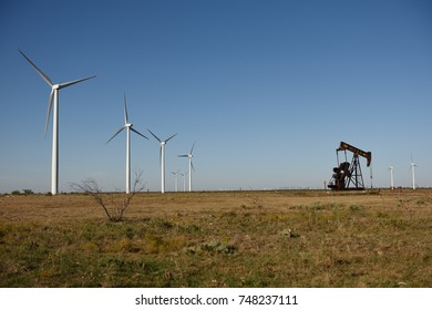 Wind power technology and oil well pump jack in rural West Texas / USA.