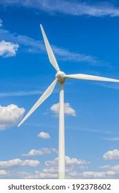 wind power turbine wind wheel on blue cloudy sky Energy industry