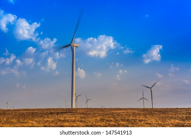 wind power turbines on a hill in morning