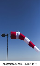 Wind sock on a clear blue sky