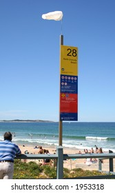 Wind sock on sign at North Cronulla Beach