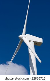 A wind turbine against a blue sky