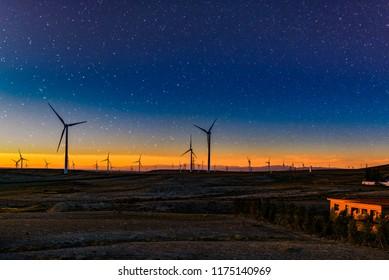 Wind turbine against mountain