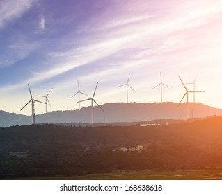 Wind turbine against mountain