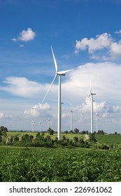 Wind Turbine for alternative energy on background sky on Cassava plantation