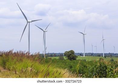 Wind Turbine for alternative energy on background blue sky