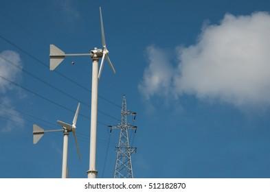 Wind Turbine for alternative energy on background sky