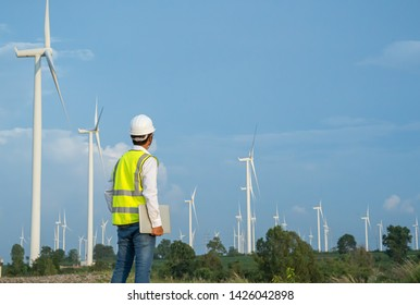 Wind Turbine Asian Mechanical Engineer working by laptop computer at Wind Turbine field,wind power and Alternative energy concept,Electric power industry,