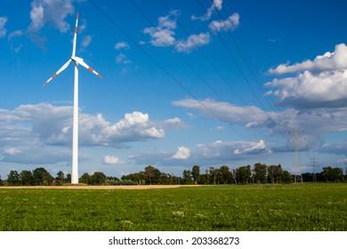 Wind turbine behind a power supply line