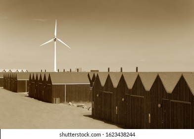 Wind turbine behind sheds in sepia