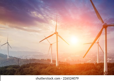 Wind Turbine from below with sun creating lens flare