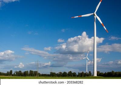 Wind turbine beside a power supply line