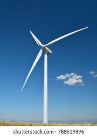 Wind Turbine, Blue Sky, and Clouds