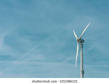 Wind turbine in the blue sky with copy space. Location: Germany, North Rhine Westphalia, Borken