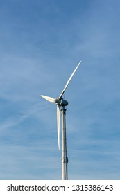 A wind turbine in the blue sky with copy space. Location: Germany, North Rhine Westphalia, Borken