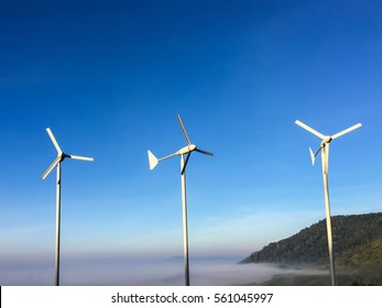 Wind turbine with blue sky line in the early morning.