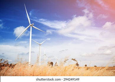 Wind turbine with blue sky, renewable energy