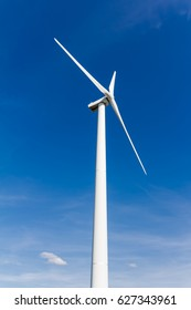Wind turbine with blue sky - renewable energy
