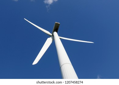 Wind turbine close up on blue sky