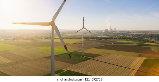 Wind turbine with coal power plant view from drone - Sustainable development, environment friendly, renewable energy concept - copyspace for your individual text