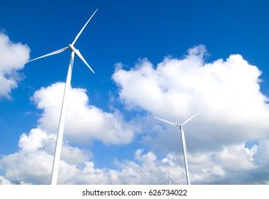 Wind turbine electricity on blue sky background
