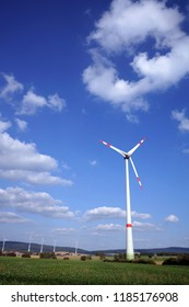 Wind turbine with energy park as background in Lower Saxony, Germany