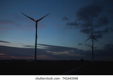 Wind turbine in the evening. Clean energy concept.