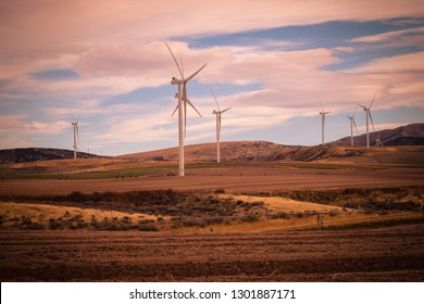 A wind turbine farm canvases the countryside, as cropland does double-duty producing green energy for Idaho.