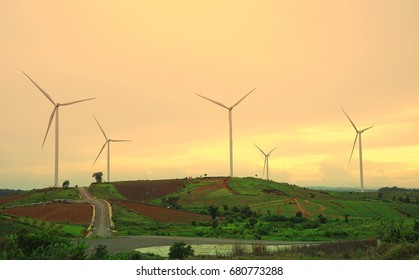 Wind turbine farm during beautiful sunset, Alternative green energy for protection of nature at  Khao Kho, Phetchabun province, Thailand