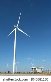 Wind turbine farm in the field - a renewable energy source