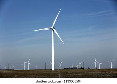 Wind turbine farm in the field - a renewable energy source.