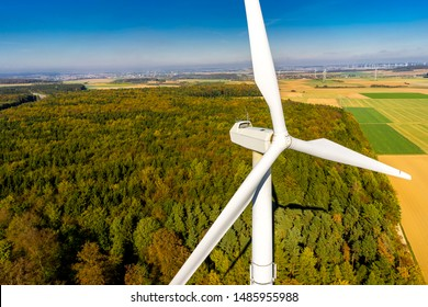 Wind turbine at the forest aerial view