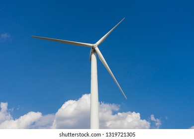 wind turbine generating electricity on blue sky.