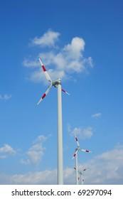 wind turbine generators on blue sky