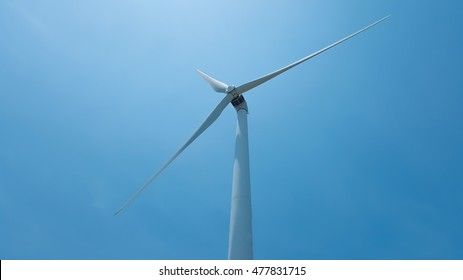 wind turbine is green energy with blue sky.