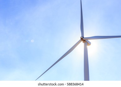 wind turbine with lens flare effect and sunlight from back side