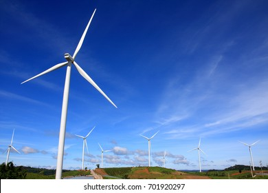 Wind turbine is located on the mountain.